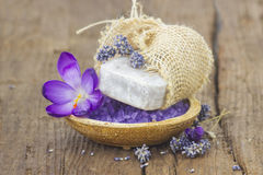 Bar of natural soap, bath salt, dried lavender and crocus Stock Photos