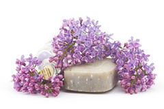 Bar of natural soap, bath salt and lilac flowers Royalty Free Stock Photography