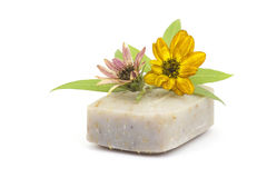 Bar of natural soap and flowers Stock Photography