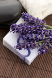 Bar of natural soap and lavender flowers Stock Photos