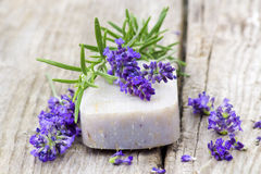 Bar of natural soap, lavender flowers and rosemary Royalty Free Stock Photography