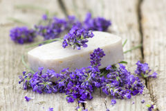 Bar of natural soap and lavender flowers Royalty Free Stock Photography