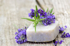 Bar of natural soap and lavender flowers Royalty Free Stock Images