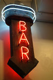 Bar Neon Sign. A neon sign with an arrow pointing down and the word Bar stock photo