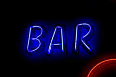 BAR neon sign with red curve Royalty Free Stock Images