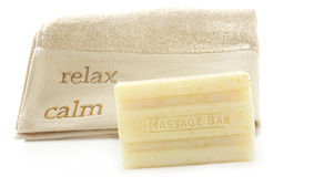 Bar of Oatmeal soap with towel on white stock images