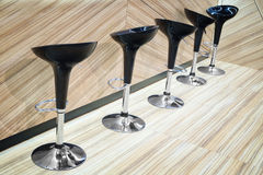 Bar or office black shiny round chairs.  Stock Photography