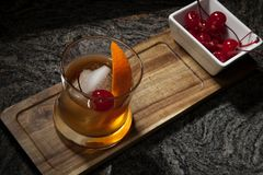 In Bar - Old Fashioned Whiskey Cocktail. Whiskey based cocktail - closeup of Old Fashioned Whiskey Cocktail on bar counter stock image