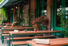 Bar in Oost, Amsterdam, Netherlands. Outside street view of long wooden tables with sign Reserve.  stock image