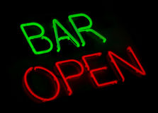 Bar open neon sign. Bar open vintage neon lights on black royalty free stock image