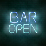 Bar open neon sign on the brick wall Royalty Free Stock Image