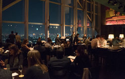 A Bar Overlooking the Big City. The New York Bar overlooking Tokyo at night in the Park Hyatt Hotel Royalty Free Stock Image