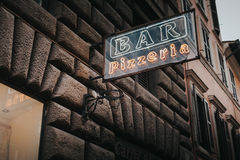 Bar pizzeria neon lettering. Stock Photography