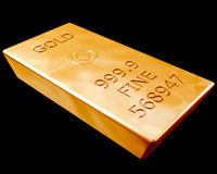 Bar of Pure Gold. Single bar of pure gold isolated on a black background Royalty Free Stock Photos