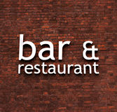 Bar and Restaurant sign. Bar & restaurant sign set on a very old red brick wall