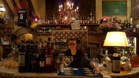 Bar in Rome, Italy with bartender Royalty Free Stock Photos
