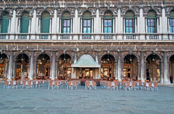 Bar in San Marco. External view of a bar with chairs in San Marco square Stock Images