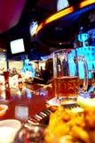 Bar scene. A glass of beer on a bar, focus on mug long exposure stock photography