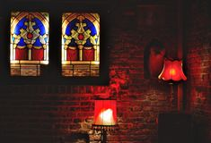 Bar scene, lustres in red and glass stained window Stock Photos