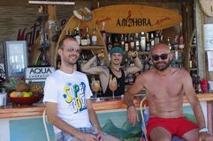Bar scene. Vacationing young tourist at a bar in Vama Veche in Romania on the Black Sea coast stock photography