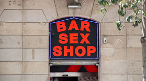 Bar Sex Shop Sign on Stone Wall Royalty Free Stock Photography