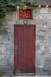 Bar Sign Above Red Door Royalty Free Stock Photography