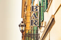 Bar sign and buildings on the city street Royalty Free Stock Photo