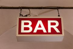 Bar sign hanging from the ceiling in the street royalty free stock images