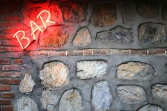 Bar sign on a stone wall Stock Images