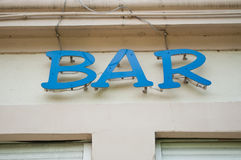 Bar signage  on an restaurant facade Stock Images