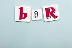 Bar signboard. Handwritten colors letters. Light blue background. Royalty Free Stock Photo