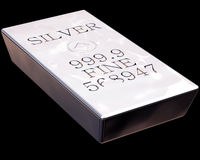 Bar of Silver. Single bar of pure silver isolated on a black background Royalty Free Stock Photo