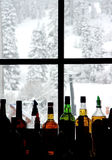 Bar at the ski resort. Colorful bottles at the ski resort royalty free stock photos