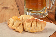 Bar snack, stuffed wontons and beer Stock Photo