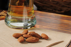 Bar snacks, beer and almonds Royalty Free Stock Images