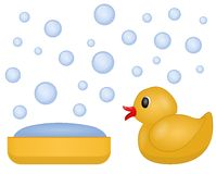 A bar of soap and a rubber duck. Rubber duck to play in the bathroom for children, a bar of soap and floating soap bubbles Royalty Free Stock Photography