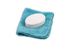 Bar of Soap and Washcloth. New bar of white soap on a blue washcloth isolated on a white background Royalty Free Stock Photos
