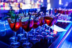 Bar stand with cocktails. In a nightclub on the bar are cocktails in wine glasses royalty free stock images