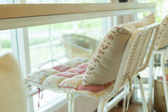 Bar stool with pillow cushion flowers pattern interior Stock Photos