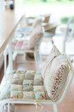 Bar stool with pillow cushion flowers pattern interior Stock Image