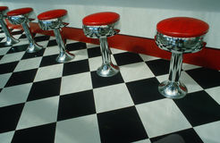 Bar stools and checkered floor in diner. Art deco restaurant with checkered floor and red bar stools in Niagara Falls, NY Stock Image
