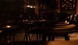 Bar stools in a dark bar royalty free stock images