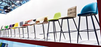 Bar stools in furniture store stock photos