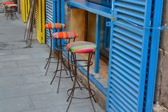 Bar stools. Multicoloured bar stools outside a bar Royalty Free Stock Images