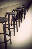Bar stools in a row Royalty Free Stock Photography