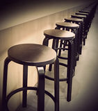Bar stools in a row Royalty Free Stock Photos