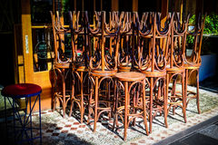 Bar stools stacked together. In front of a restaurant Stock Photography