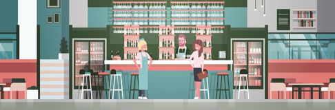 Bar Stuff Bartender, Waiter And Administrator Standing At Counter Over Bottles Of Alcohol And Glasses On Background Stock Images