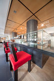 Bar in sushi restaurant with red chairs Stock Photo