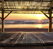 Bar table at the beach. Empty bar table against sunset at the beach Stock Photography